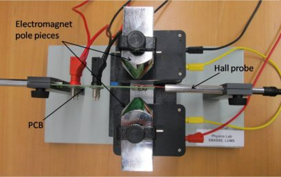 5. Top view of printed circuit board (PCB) and Hall probe placed vertically in between the pole pieces of electromagnet.